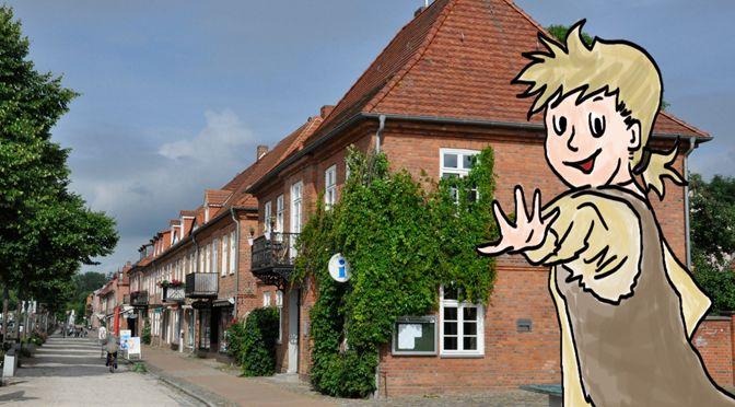 """Kinder werden von Johann begleitet, dem Jungen aus """"Lulu″, der sich hinter den Kulissen seiner Heimatstadt gut auskennt."""